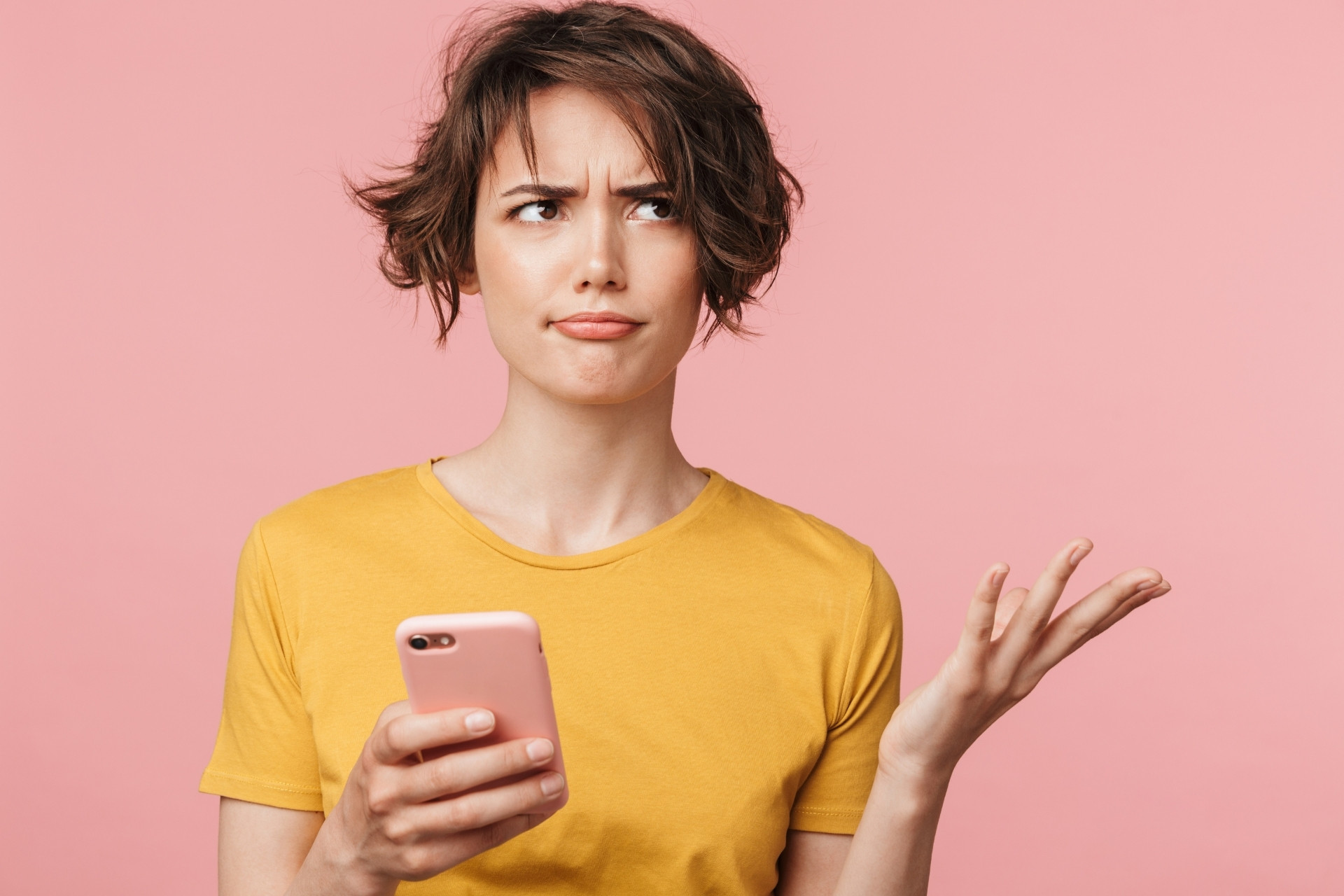 Confused woman with mobile phone